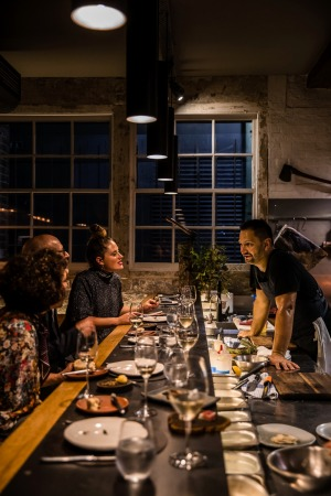 Firedoor chef Lennox Hastie chats to guests with a ringside seat at the bar.