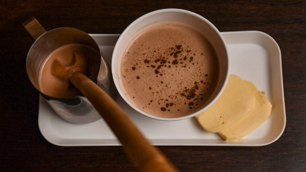 Pour the hot chocolate over the mozzarella then froth with the paddle.