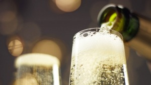 Sparkling wine being poured into glass.