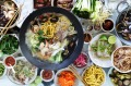 Gather a group around a table for the ultimate in interactive dining: the traditional Chinese steamboat.