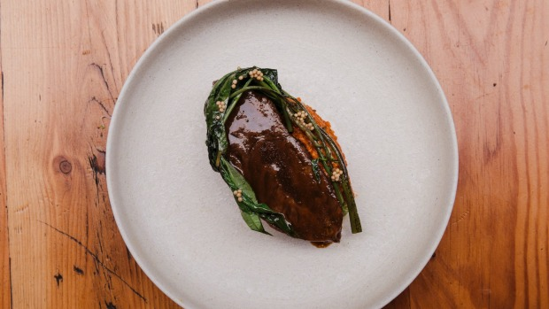 Luscious beef cheeks with capsicum and ong choy (water spinach).