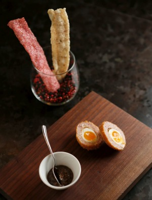 Bar snacks: Scotched quail egg and duck and beetroot crackers are included in the flight.