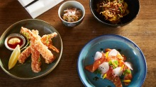 Food is designed to share, such as (clockwise from top right) kimchi and seafood dumplings, salmon with pickled fennel ...