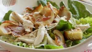 Caesar salad with barbecue chicken or chicken thighs.