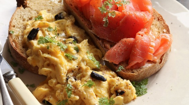 Scrambled eggs with smoked ocean trout and smoky-sweet black garlic.