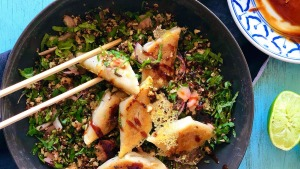 Lacy potsticker dumplings on a bed of roasted cauliflower, herb and pickled ginger salad.