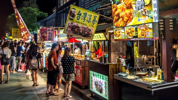 Visit the night markets to experience Taipei's street food.