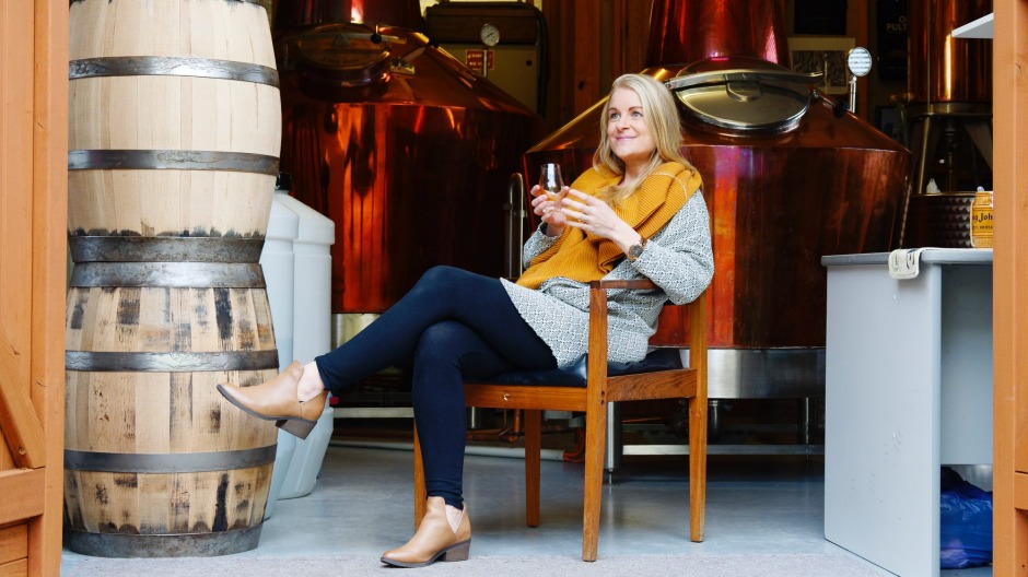 Jane Sawford relaxes with a glass at Sawford Distillery.