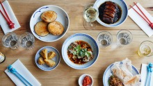 Clockwise from top left: Mapo tofu jaffles, moy choy (pork belly with mustard greens), pepper beef tartare, steamed ...