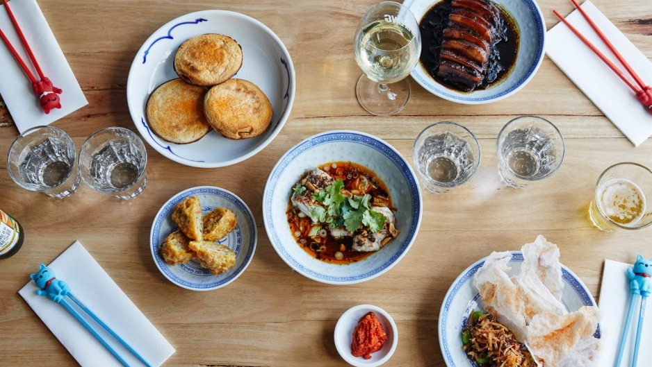 Clockwise from top left: Mapo tofu jaffles, moy choy (pork belly with mustard greens), pepper beef tartare and steamed ...