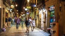 People stroll on a street in San Sebastian, Basque Country, Spain.