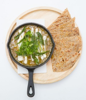 Indian-inspired baked eggs and flatbread.