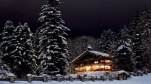Museum Restaurant in St Anton, an Austrian chalet beneath pine trees glittering with ice and fairy lights.