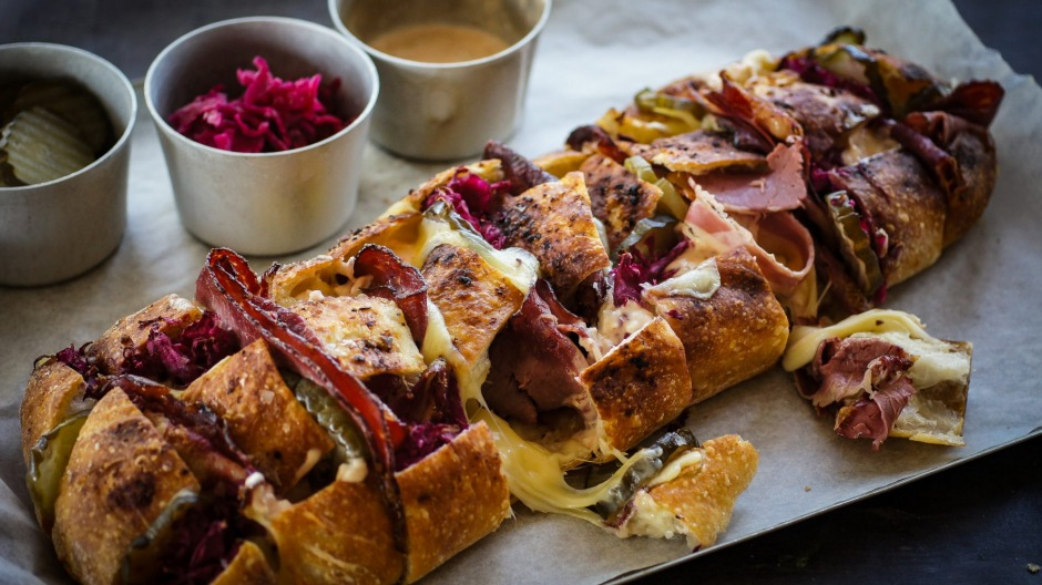 Share-friendly reuben sandwich drizzled with Russian mayo.