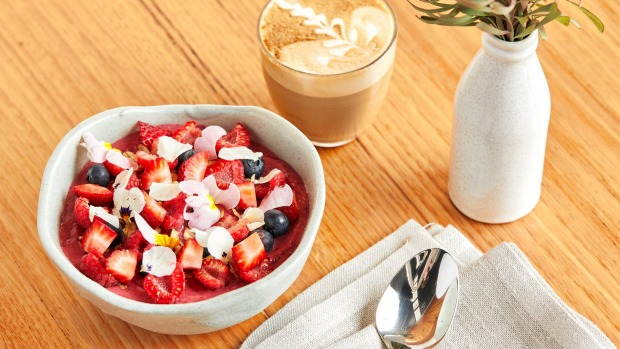Acai bowl with honey granola and winter berries.