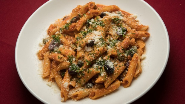 Penne puttanesca pinging with garlic, anchovies and tomatoes.