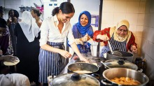 Meghan Markle, the Duchess of Sussex, cooks with women in the Hubb Community Kitchen in London.