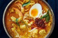 This coconut-based laksa recipe makes double the flavour-base paste (rempah).