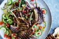 Barbecued lamb cutlets with spicy mint and cucumber salsa.