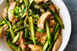 Kylie Kwong's stir-fried chicken fillets with fresh asparagus spears.