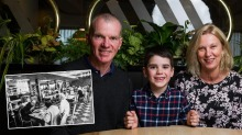 Lex and Toni Courage, with son Benjamin, 6, in front of the iconic golden grills.