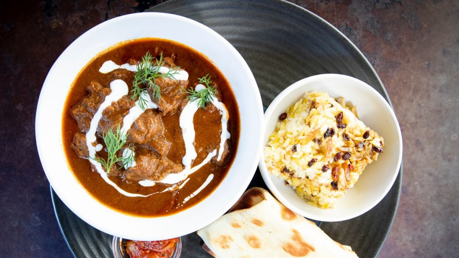 Goat curry with grilled roti bread, almond rice pilaf and lime pickle.