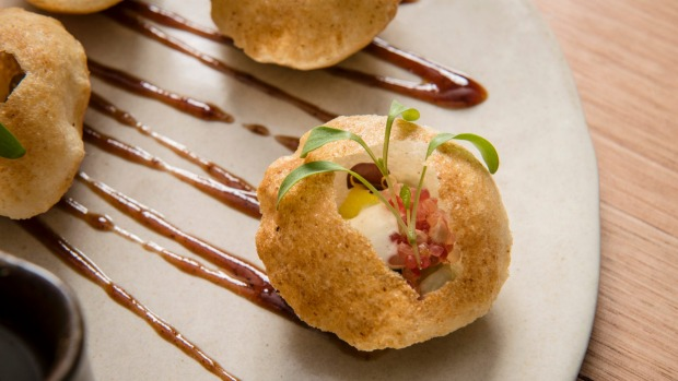 Pani puri - crisp semolina puff with sprouts, finger lime and mint water.