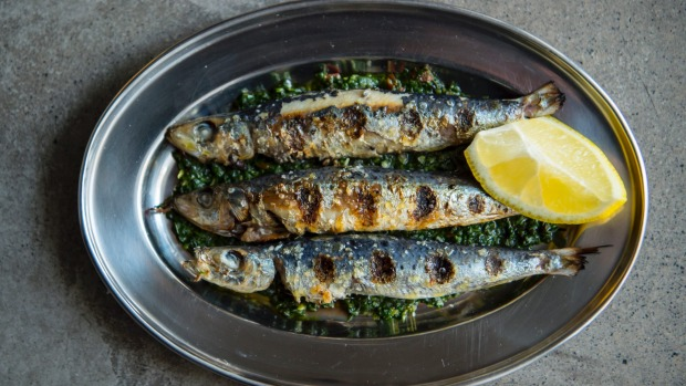 Grilled sardines with salsa verde.