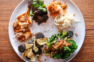 Build your own tasting plate, perhaps (pictured clockwise from top left) Korean-style beef short rib, pickles, miso ...