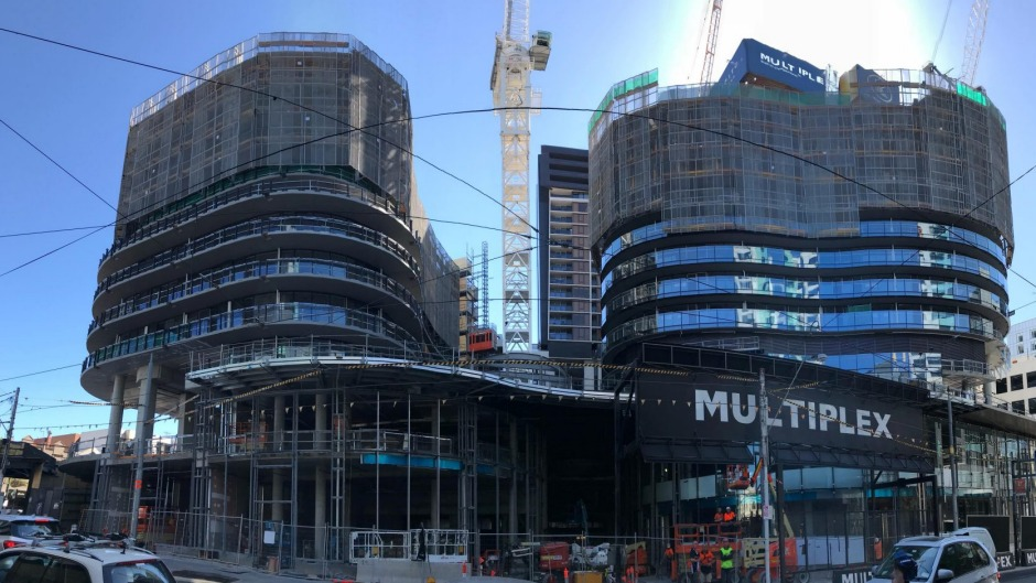 LK Property Group's Capitol Grand (left) being built in Melbourne's South Yarra.