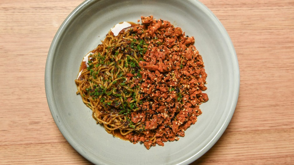 Coming in hot: XO noodles and spicy chicken skin at Sunda in Melbourne.