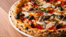 The classic napoletana carries no more than tomato, fior di latte, capers, olives and anchovies.