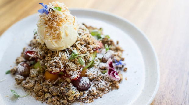 The brekkie crumble, a vibrant mix of fruit, oat, pistachio and cashew crumble and vanilla mascarpone.
