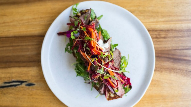 Lamb and haloumi open rye with beetroot slaw.