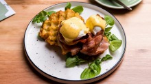 Poached eggs on waffled hash brown, maple glazed bacon and apple cider hollandaise at Parkstone in Pascoe Vale South.