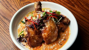 Crispy skin master stock free-range chicken with special satay sauce.