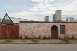 Behind this plain brick fence is a Half Acre, a restaurant, bar and event space in South Melbourne.