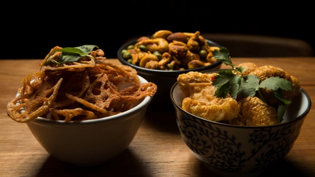 Lotus root chips, five-spiced pork scratchings and The Colonel's spiced nuts at Luxsmith.