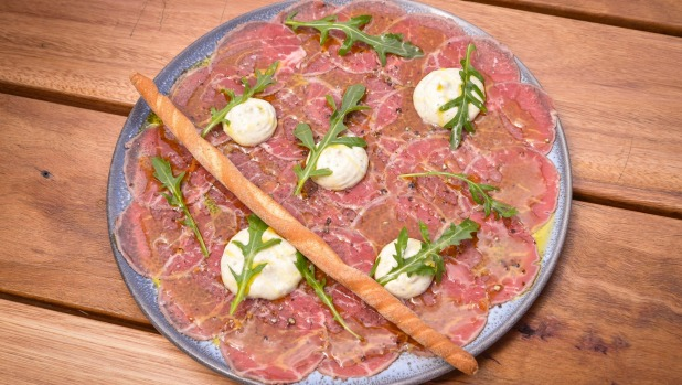 Beef carpaccio, sliced as thin as tissue paper.