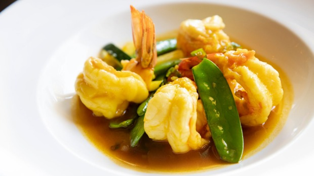 King prawns with snowpeas, zucchini and saffron and pomegranate sauce.