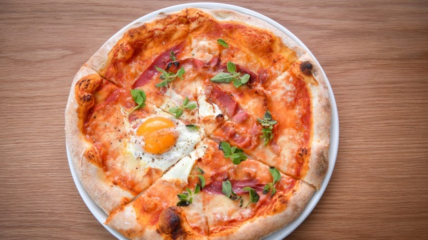 Pancetta and egg pizza, on a chewy base.