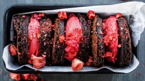 Brownie rounds sandwiching raspberry sorbet.