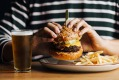 Pub classics such as burgers and fish and chips are on the menu at the Beach Hotel, Albert Park.
