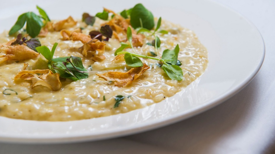 Seasonal globe artichoke risotto with stracchino cheese.