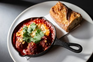 Xiu mai - chicken and veal meatballs baked in tomato sugo with tofu and egg.