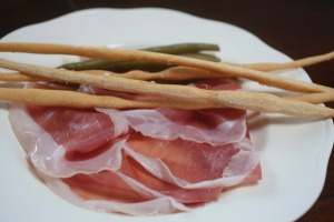 Go-to dish: Prosciutto di Parma with pickled green beans and hand-rolled grissini.