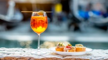 Aperol spritz with cicchetti (traditional Venetian snacks) on the canal in Venice.