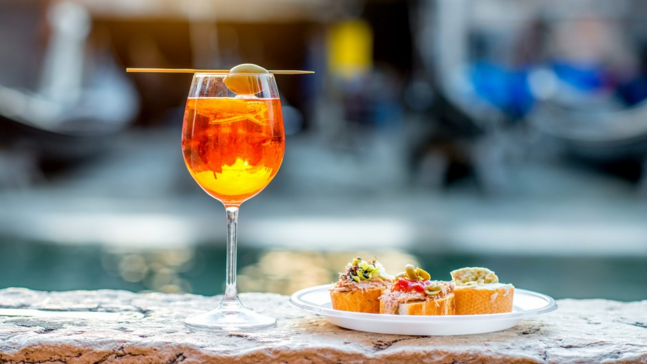 Aperol spritz on the canal in Venice.