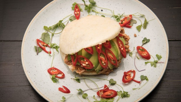 White corn arepa filled with pulled chicken, sour cream, avocado and chilli.