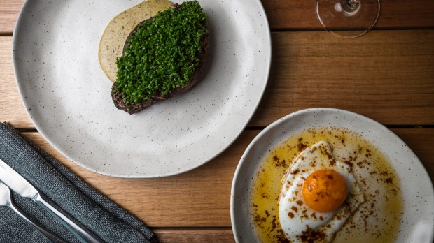 Chive covered steak and optional duck egg.